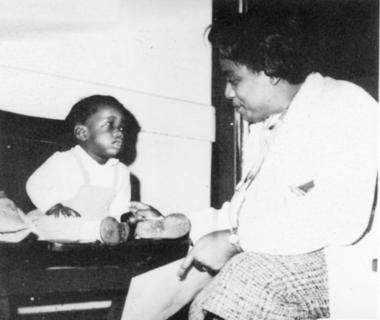 Ethel D. Allen with a young child