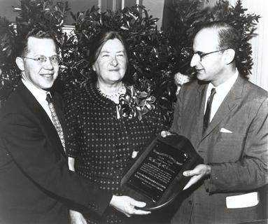 Dorothy H. Andersen, accepting an award for her discovery of Cystic Fibrosis from Robert Natal (right), president of the New York Chapter of the National Cystic Fibrosis Foundation and Victor Blitzer, former president, 1958