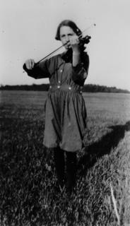 Young Virginia Apgar practicing her violin in the open air, 1920s