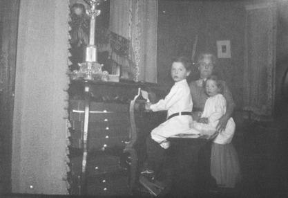 Virginia Apgar, her brother Lawrence, and her mother at home, ca. 1912