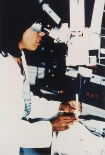 Patricia E. Bath, M.D. inserting fiber optic into human eye, testing fragment, performing cataract surgery on human eyeball at the Laser Medical Center, Berlin West Germany, 1986