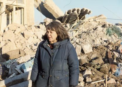 Susan Briggs surveying the damage after an earthquake in Armenia, 1989