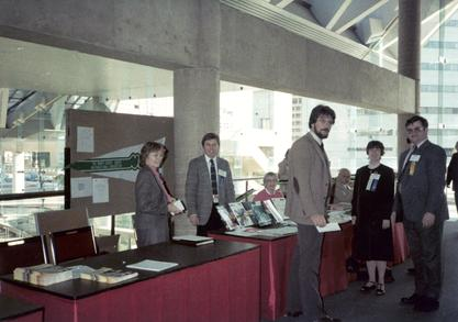 Ruth Dayhoff, pregnant with her first child, at the 1983 Symposium on Computer Applications in Medical Care.  She served as program chair for this meeting.  Peter Kuzmak, coworker at the VA on VistA Imaging System (second from left), Ruth Dayhoff (second