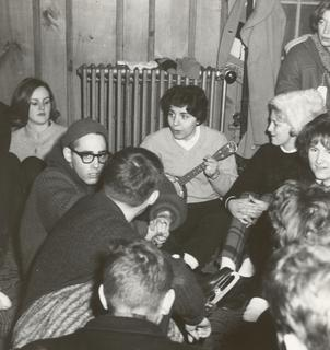 Catherine DeAngelis playing guitar, with fellow students at Wilkes College, 1960s