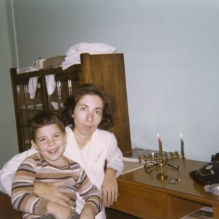 Leah Dickstein with her son Stuart celebrating Chanukah, 1969