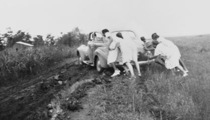 The Mississippi Health Project team pushing their car out of the mud, 1940