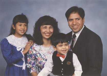Katherine Flores with her family, 1990