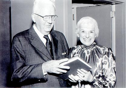 Edithe J. Levit with co-author John P. Hubbard holding their book on the National Board of Medical Examiners, 1985