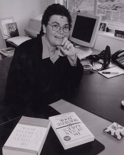 Susan Love, M.D. at her desk, with two of the books she has written for the public, ca. 2000
