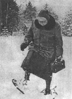 Kate Pellham Newcomb wearing snowshoes to visit patients in their homes