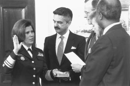 Surgeon General Antonia Novello is sworn in, as her husband, Dr. Joseph Novello, holds the Bible, March 9, 1990
