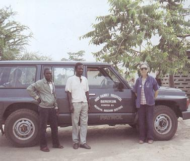Sister Fernande Pelletier and colleagues with the Holy family Hospital Patrol truck provided by the Medical Mission Sisters, 1990s