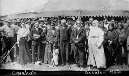 Susan La Flesche Picotte with members of the Omaha Nation on the reservation, 1910