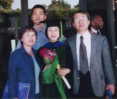 Ina Rhee with her family at her graduation from the Johns Hopkins University School of Medicine, 2002