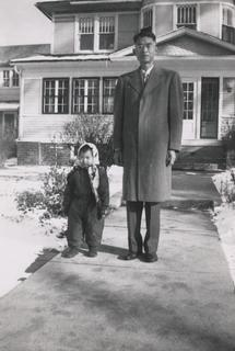 Rebekah Wang-Cheng as a young girl with her father, ca. 1955