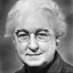 Full face photograph of Dr. Virginia Apgar wearing glasses.