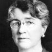 Full face photograph of Dr. Louise Pearce wearing glasses.