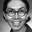 Full face photograph of Dr. Fernande Marie Pelletier wearing glasses.