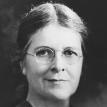 Full face photograph of Dr. Martha May Eliot wearing glasses.
